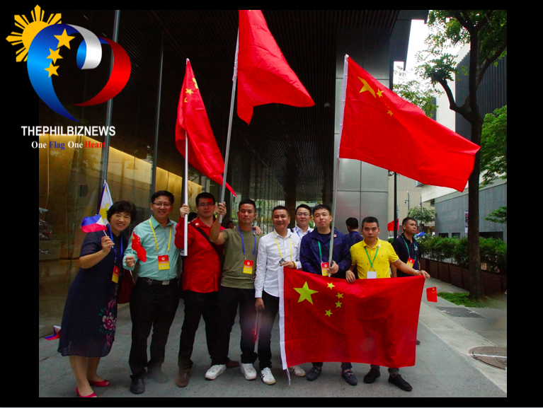 Chinese contigents brandish their flags